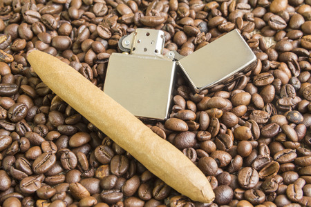 large bean: cigar and cigarette lighter on the coffee beans background