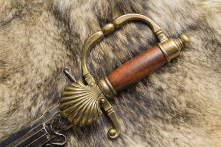 memorabilia: Ephesus antique swords on the fur of a wild Wolf Stock Photo