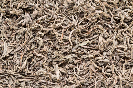 plano: Background from dried leaves of Ceylon black tea close up Stock Photo