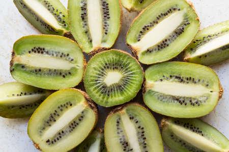 pips: Fresh organic Kiwi Fruit Slices arranged showing the pips & structure