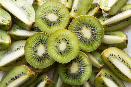pip: Fresh organic Kiwi Fruit Slices arranged showing the pips & structure