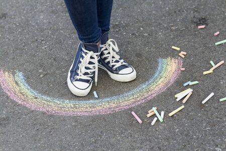 Feet in sneakers before rain