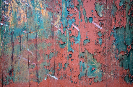 Old grunge wooden fence with peeling colorful paint Stock Photo - 24446641