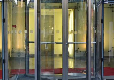hotel building: Modern revolving door as entrance to office building or hotel Stock Photo