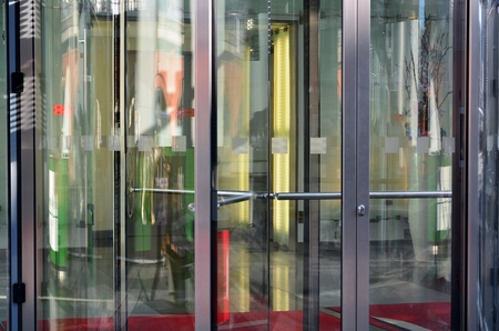 revolve: Modern revolving door as entrance to office building or hotel Stock Photo