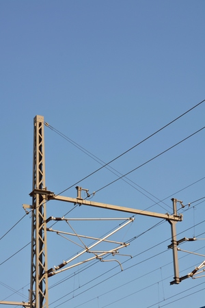 power cables: Industrial high voltage power cables against blue sky