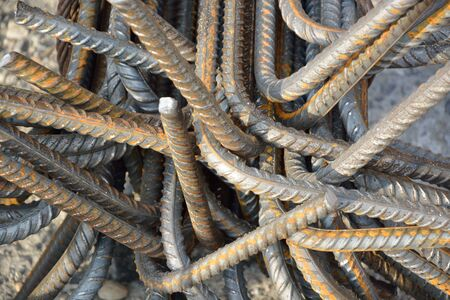 construction material: Grunge rusty iron rods lying at construction site
