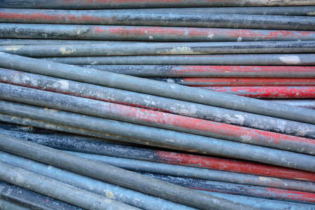 metal pipes: Rusty grunge metal pipes lying at construction site