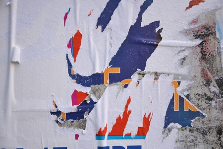urban decay: Colorful torn posters on grunge old walls as creative and abstract background