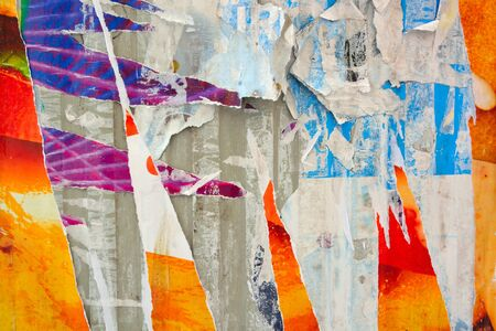 torn: Colorful torn posters on grunge old walls as creative and abstract background