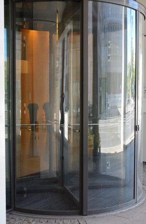 Glass revolving door stock photos royalty free business images modern revolving door as entrance to office building or hotel stock photo planetlyrics Image collections