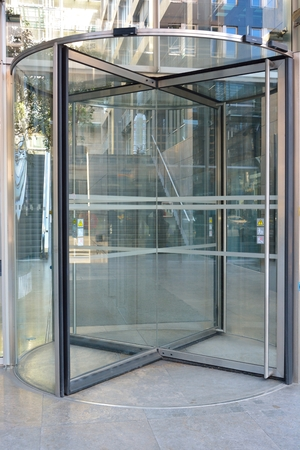 Modern revolving door as entrance to office building or hotel Stock fotó
