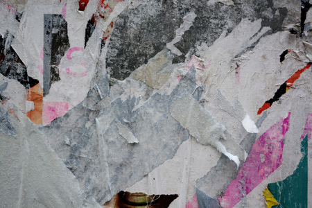 Colorful torn posters on grunge old walls as creative and abstract background with space for text Banco de Imagens