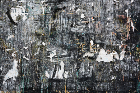 Colorful torn posters on grunge old walls as creative and abstract background with space for text Standard-Bild