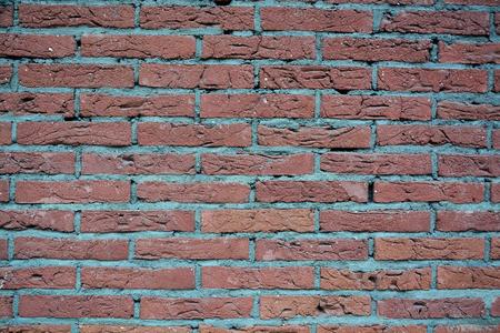Modern urban wall in brick-pattern style as creative background Standard-Bild