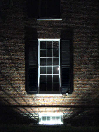 jalousie: Illuminated window Stock Photo