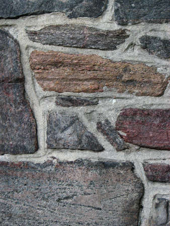morter: A close-up of a square stone wall Stock Photo