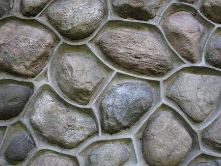morter: A close-up di un muro di pietra rotonda
