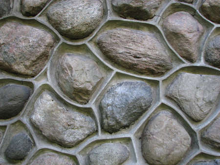 A close-up of a round stone wall photo