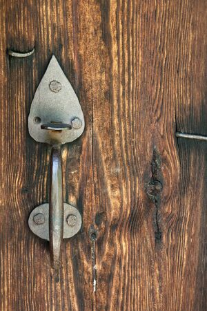 the outmoded: A metallic handle of door is in an old house