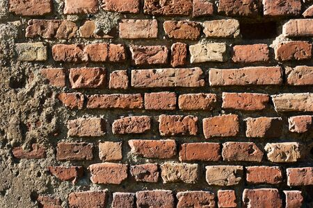 horizontals: Red brick wall of old house