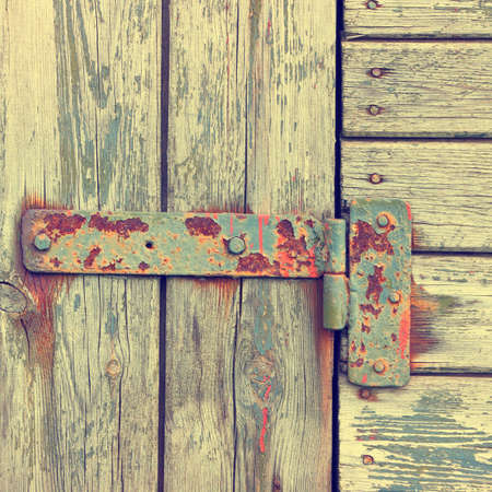 the outmoded: Metallic loop on an old wooden door Stock Photo