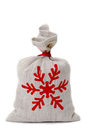 linen bag: Small linen bag with gifts on a white background Stock Photo