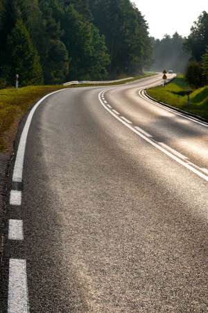 early morning: A winding road with markings in the early morning Stock Photo