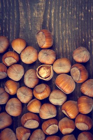 booty: Lots of hazelnuts scattered on a wooden board