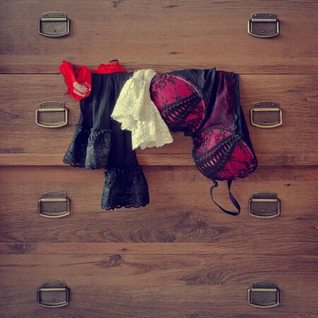 undies: Colored lingerie and stockings hanging on the dresser