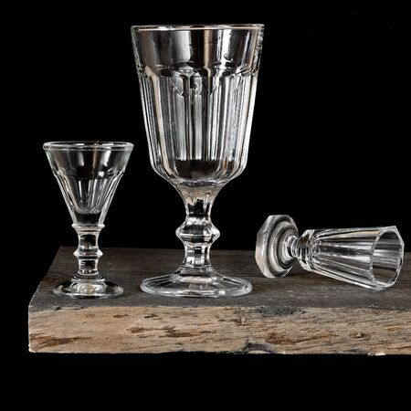 Three glass wine glasses on a wooden board Stock Photo
