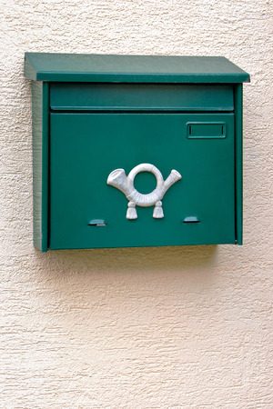 mailmen: Green mailbox on a concrete wall of a house