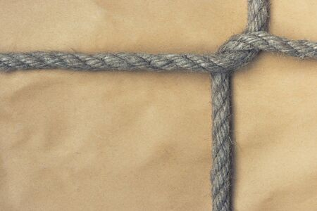 addressee: A parcel is bandaged by a rope