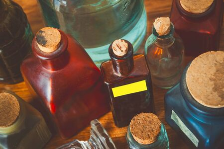 Coloured glass pharm bottles with corks.Kind from above