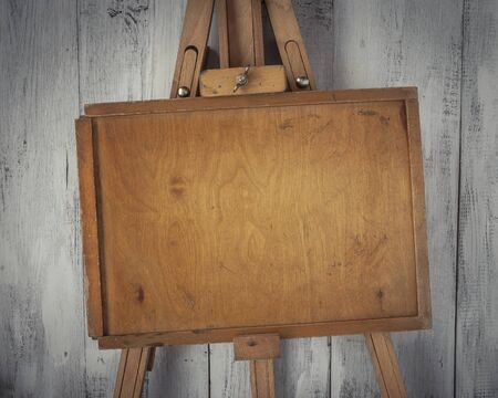 plywood: Wooden artist easel with an old plywood sub-frame Stock Photo