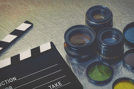 Clapperboard, lenses and filters on the table