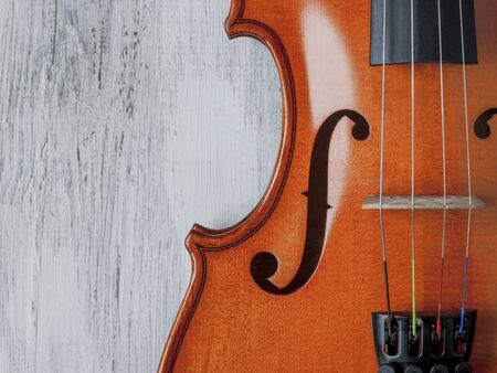 Violin close-up shot on an old table the painted