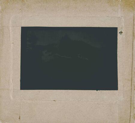 Old glass negativity in a cardboard frame