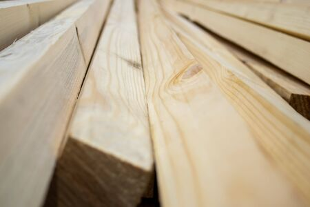 Wood, timber, construction material stacked in warehouse. For background and texture. close-up.