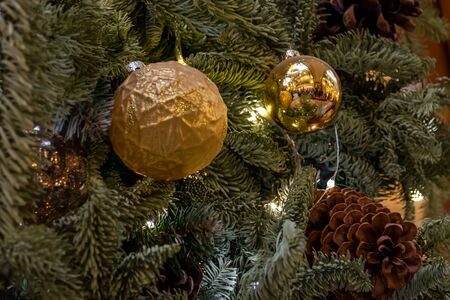 Christmas decorations. Composition of Xmas toys, cones and branches of spruce. Glowing garland. Close-up. Banque d'images