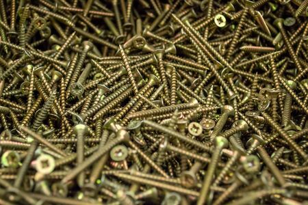 Large number of metal, steel screws. Macro. Close-up. Background and texture.