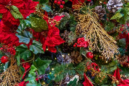 Xmas decorations. Ð¡ollage of flower petals, berries, apples, Golden branches, cones, garlands, and Christmas tree branches. Close-up. Xmas
