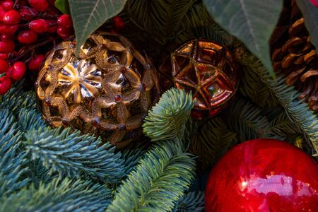 Xmas decorations. Composition of Christmas toys, cones and branches of spruce. Close-up.