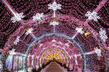 Futuristic tunnel of LED lights. Christmas lights, garland. Фото со стока