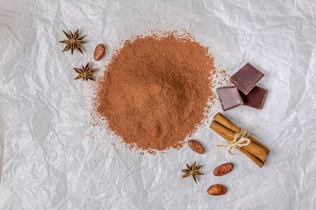cocoa powder cocoa beans star anise cinnamon on crumpled paper 写真素材