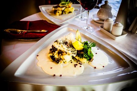 zander: Zander fillet fish on triangle plate