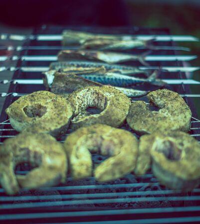 coal fish: fish on grill