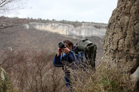 Tourist-photographer with a back-pack and SLR Camera Stock Photo - 7056569