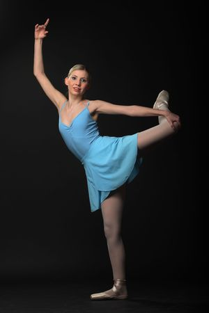Beautifull young blond ballerina dance photo