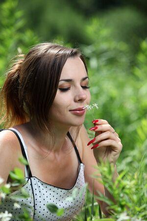 Pretty girl smell a flower photo